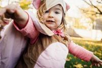 Portrait of cute baby girl wearing bird costume