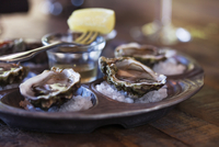 Oyster shells served on table