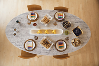 Overhead view of food served on dining table at home