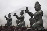 Buddha statues against mountain