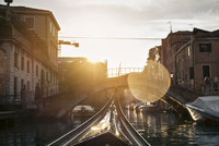 Gondola on canal in city during summer