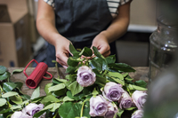 Midsection of florist working in flower shop