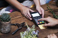Cropped image of customer paying with credit card