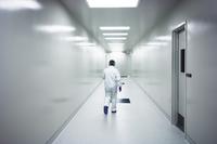 Rear view of scientist walking in corridor
