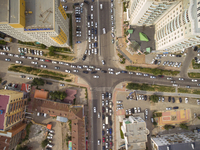 Overhead view of traffic at crossroad in city