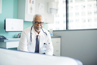 Portrait of confident doctor in clinic