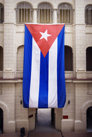 Huge Cuban flag hanging from building