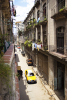 High angle view of cars on street amidst buildings