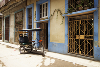 Rickshaw parked on street