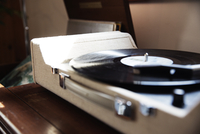 Close-up of record player on table at home