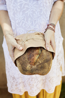 Midsection of woman holding bread