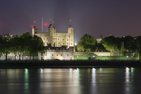 Tower of London by river at night