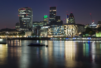 London skyline and Thames river at night
