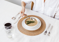 High angle view of woman dipping spoon in soup at dining table 11100045013| 写真素材・ストックフォト・画像・イラスト素材|アマナイメージズ