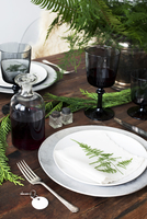 High angle view of red wine and crockery on dining table