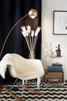 Fur blanket on rocking chair in modern sitting room