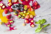Overhead view of fruits on marble counter