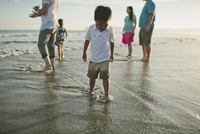 Family enjoying in sea during sunset