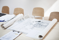 High angle view of blueprints on desk in creative office