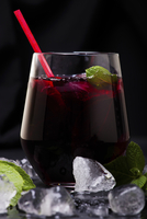 Close-up of drink against black background