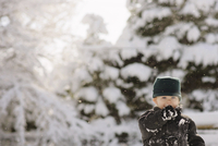 Portrait of boy in warm clothing at forest