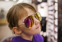 Close-up of girl wearing sunglasses at shop