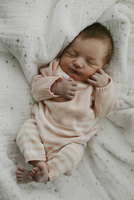 Overhead view of baby girl sleeping with eyes closed on blanket 11100047075| 写真素材・ストックフォト・画像・イラスト素材|アマナイメージズ