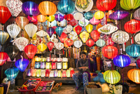 Owner selling various multi-colored lanterns in shop