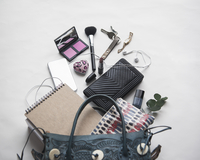 High angle view of personal accessories on white background