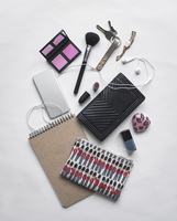 Overhead view of personal accessories on white background
