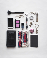 High angle view of accessories arranged on white background