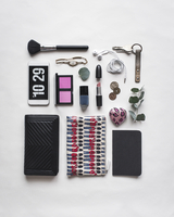 High angle view of personal accessories arranged on white background