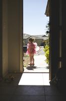 Girl wearing fairy costume seen from doorway