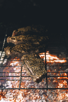 High angle view of steak on barbeque grill