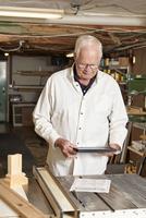 Man using tablet computer in workshop