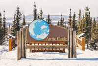 Dalton highway with Arctic Circle sign during winter