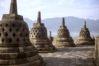 Stupas at Prambanan temple against mountains=-=