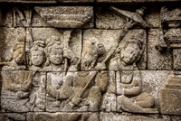 Human carvings on walls of Prambanan temple against clear sky