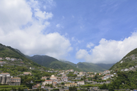 Village amidst mountain against sky