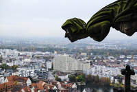 Gargoyle of Ulm Minster church by cityscape against sky
