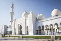 Low angle view of Sheikh Zayed Mosque against clear blue sky on sunny day