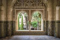 Arabesques around windows of Alhambra Palace