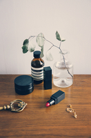 High angle view of beauty products on wooden table 11100051028| 写真素材・ストックフォト・画像・イラスト素材|アマナイメージズ