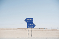 Signboards on desert against clear sky