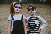 Portrait of siblings with face paint during Halloween