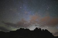 Scenic view of silhouette rock formation against star field at night