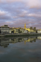 Scuola del Cuoio by Arno river against cloudy sky during sunset in city