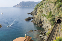Scenic view of mountains by sea at Cinque Terre