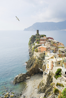 High angle view of town by sea against cloudy sky at Cinque Terre