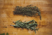 Overhead view of rosemary with thymes on wooden table